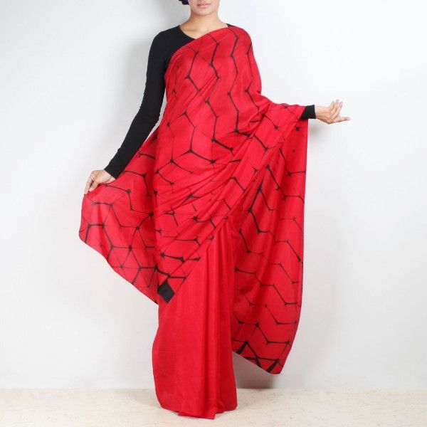 Red & black shibori saree has subtle blocks tie & dyed all over. The rich red can be perfected with your choice of blouse making it ready to wear for any occasion.  www.tadpolestore.com  #sarees #designersarees #women #clothes #designer #onlineshopping #TadpoleStore #fashion #buyonline #ethnic #buysarees #IndianSarees