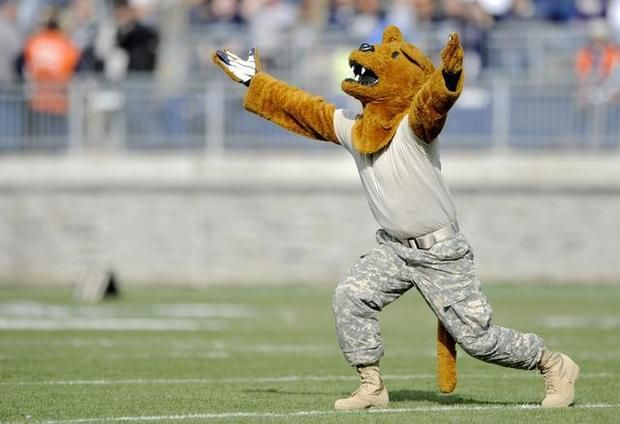 Dressed in fatigues for military appreciation day, the Penn State Nittany Lion amps up the crowd before the Saturday, November 16, 2013 Penn State football game against Purdue at Beaver Stadium. ABBY DREY — CDT photo
