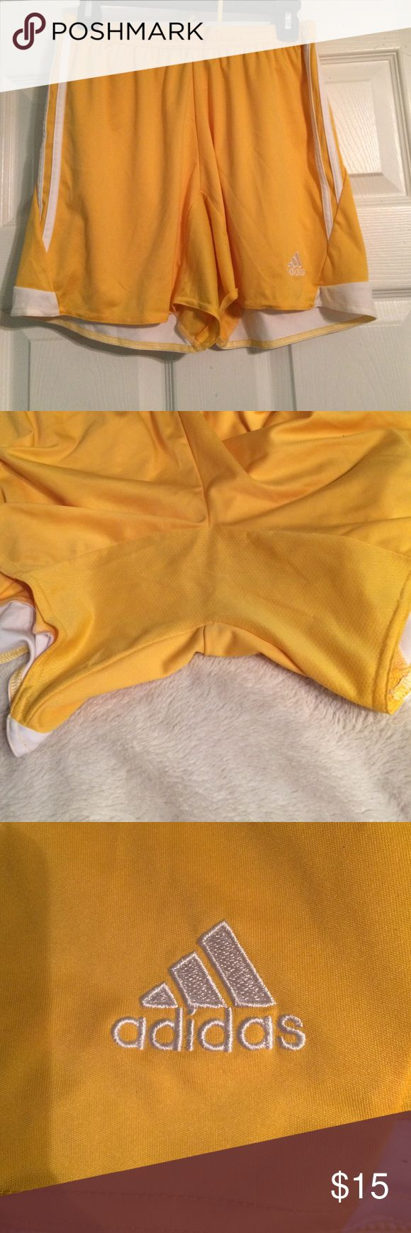Yellow adidas soccer shorts Never worn before!! Brand new no tags bought online to go with a goalie jersey but the yellows didn't match Adidas Shorts