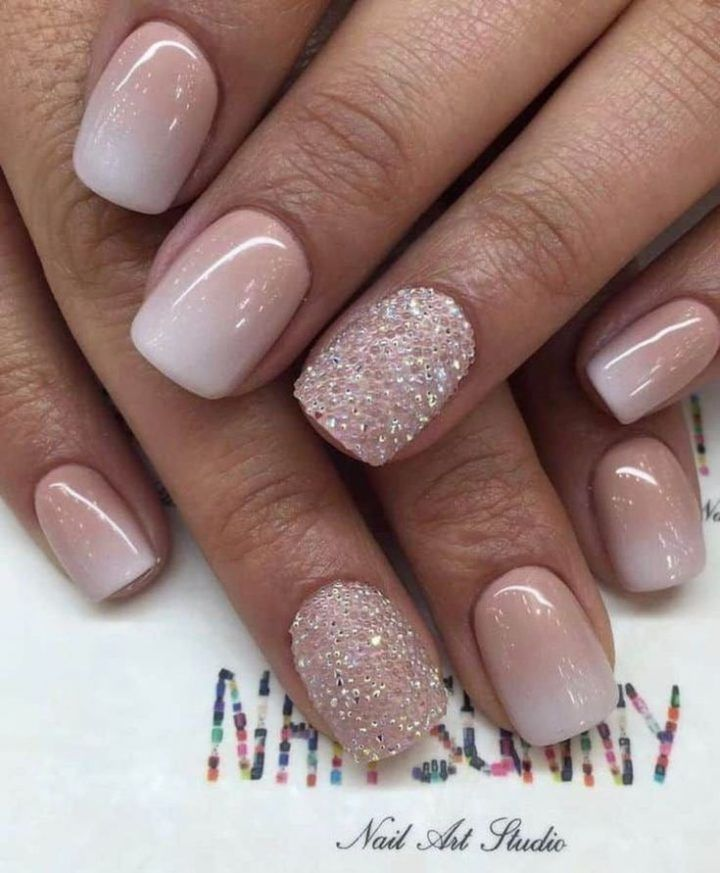Add a little sparkle to your nails to complete your bridal look! These nude ombr…