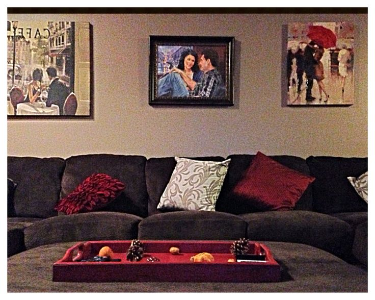 Our living room. Extra large sectional w/ chaise lounge & ottoman from Nebraska Furniture Mart. Pillows/pillow covers from Bed Bath & Beyond Paintings from Bed Bath & Beyond & Kohl's... minus the middle one :) (That was a hand-painted wedding gift) Red shag rug from Walmart. Display tray- I bought it from a garage sale & redid it.  #Red #Brown #Cream Walls- painted in Valspar Mink -25%