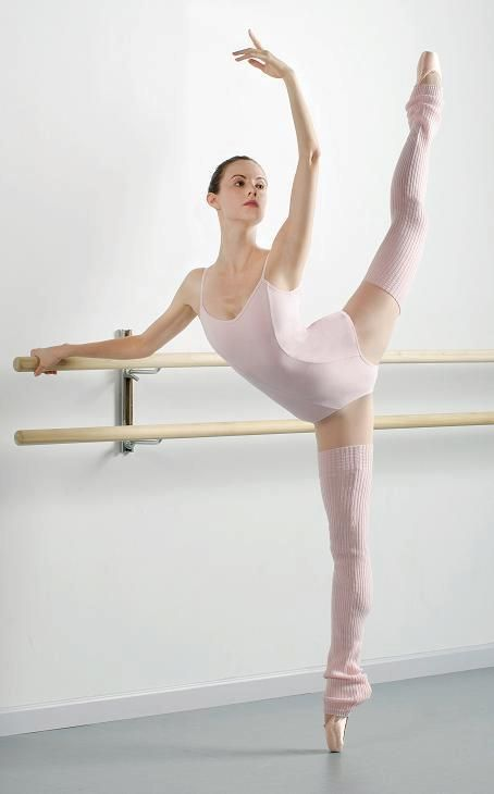 "Faye Arthurs of New York City Ballet wears our Princess Camisole Leotard (CC101) and Harmonie 36"" Legwarmers (CS103)."