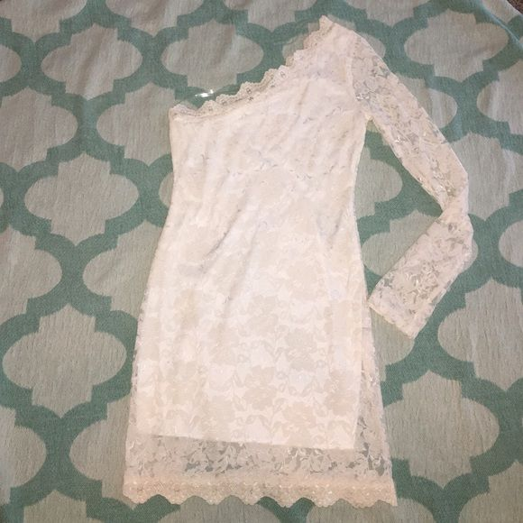 White lace dress with attached lining One sleeve, never worn. I'm 5'3 and dress hits halfway up the thigh. Great party/Vegas dress! Dresses Mini