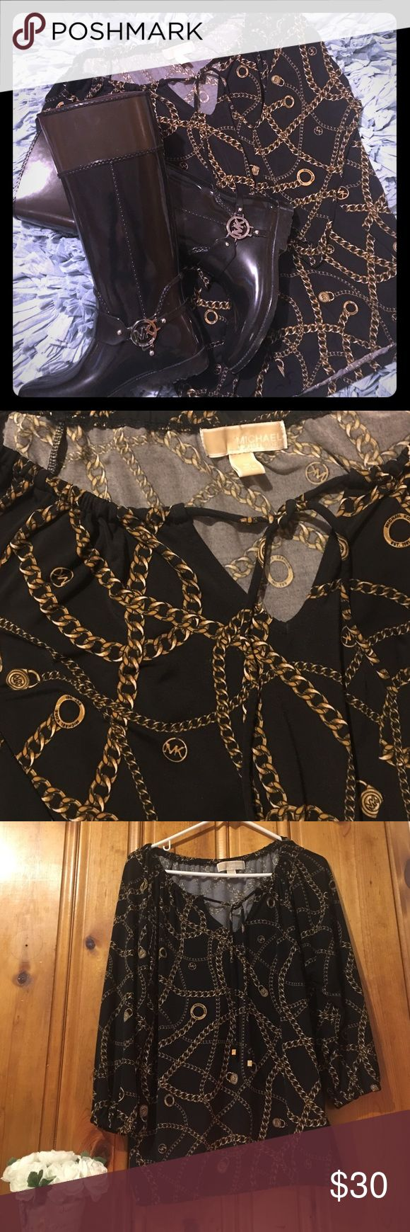 Michael Kors blouse Black and gold blouse. Super classy and looks amazing with skinny jeans and boots. Nice flowy loose fit. Michael Kors Tops Blouses