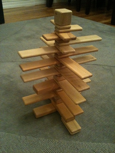 Check out this tower of planks made from #Tegu magnetic ...