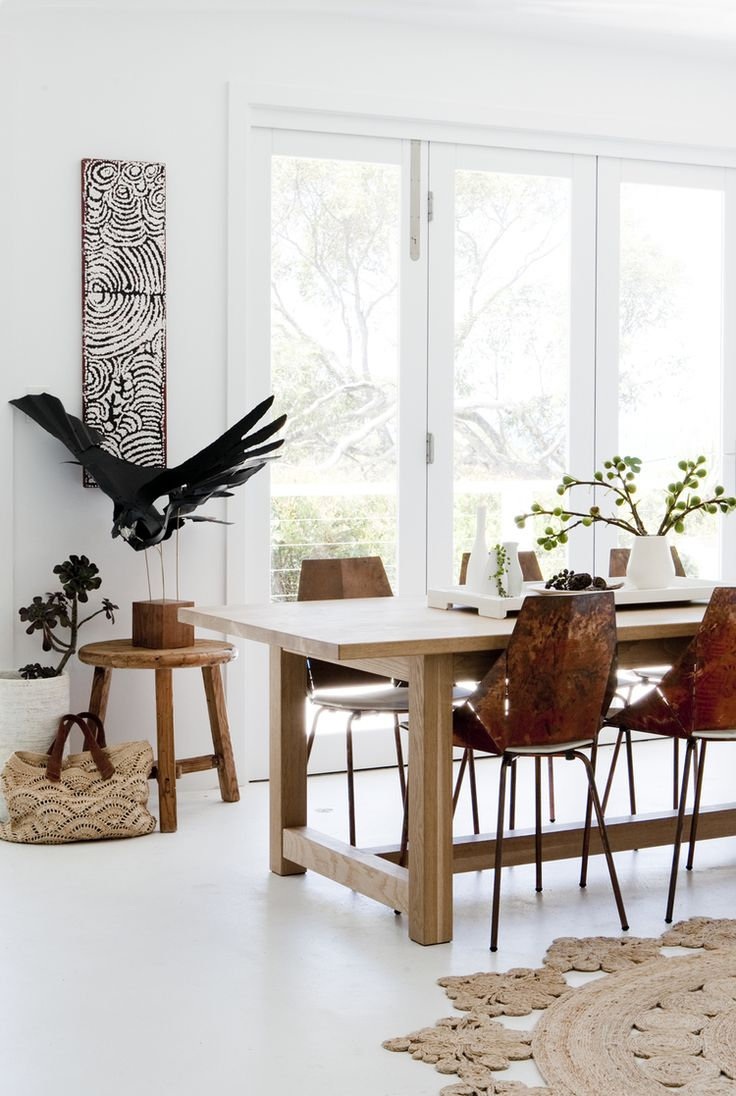 Dining room in the home of designer Marika Jarv // Copper Real Good chairs by BluDot / Armadillo & Co rug / Mr & Mrs White custom-made dining table / Anna Wili Highfield paper sculpture