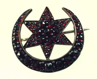 """Victorian Bohemian Garnet Moon and Star Motif Pin  A very good example of a Victorian rose cut garnet moon and star pin set in GF metal. The classic design is perfectly executed and measures 1 18"""" round. Gorgeous red, hand cut natural garnets measure from 4 mm down to a tiny 1 mm."""