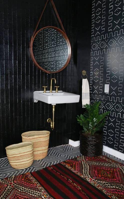 a dark, pattern-filled, boho bathroom.