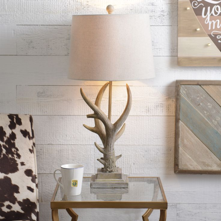 Brighten up your dad's home with a lamp he will love! Natural hues and a soft glow make our Natural Antler Table Lamp the perfect blend of rustic and classic.
