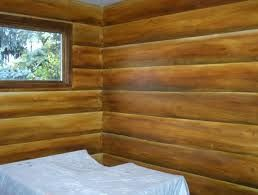 Paint your walls to look like a log cabin.  I'm doing it!
