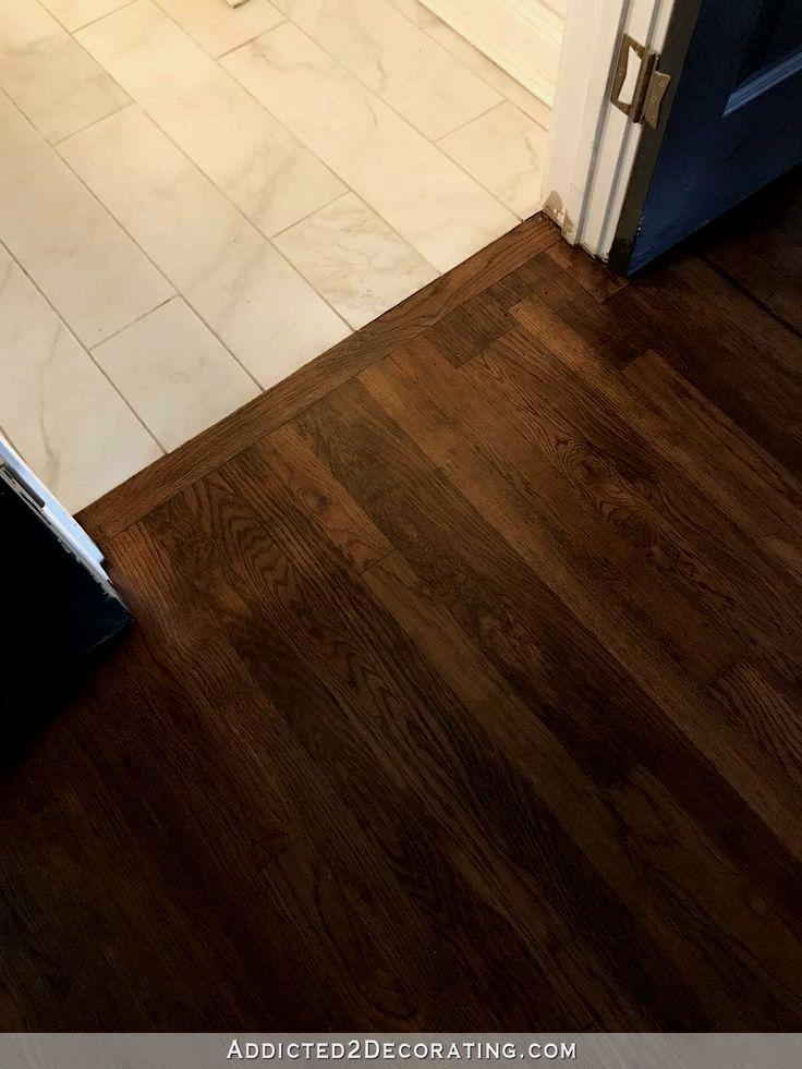 Refinished Red Oak Hardwood Floors Transition Between Hallway And Tiled Bath Red Oak Hardwood Floors Flooring Red Oak Hardwood
