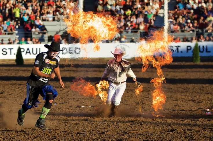 "Rider Kiesner chases J.J. Harrison with flaming whips. Bull riders battled it out as the St. Paul Rodeo hosted The Professional Bull Riders ""Best of the West"" Pro Tour."