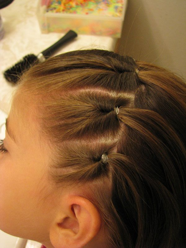 Different than the usual ponies...  Now if she'll just let me do this to her hair.