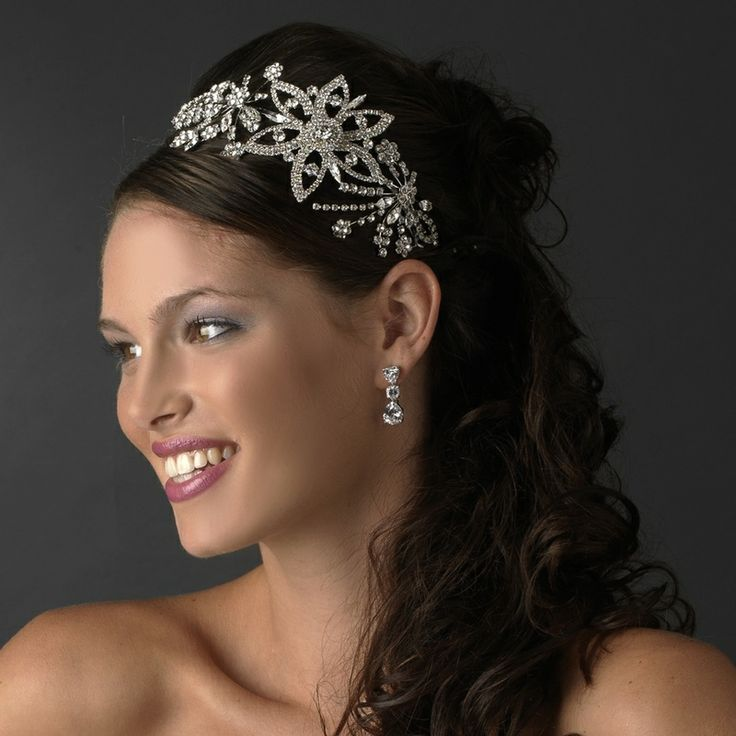 Vintage Style Side Accent Headband|oneclassicwedding.com This vintage inspired headband is offered in Silver plating or Antique Silver plating and features a sparkling combination of crystals, rhinestones, and a large silver-plated floral design. A stunning statement on your big day, this unique piece coordinates best with white, off-white and light ivory dresses. http://oneclassicwedding.com/For-The-Bride/Bridal-Tiara-Headband/Vintage-Accent-Bridal-Headband