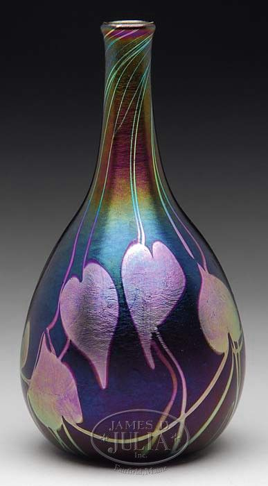 """QUEZAL Decorated Vase has platinum iridescent heart and vine decoration against a deep green iridescent background with strong purple overtones. Signed on the bottom """"Quezal N.Y.""""."""