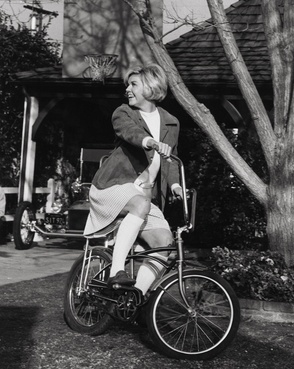 Not many people can pull off knee socks with a skirt, let alone someone that isn't in grade school. She does it like a pro.    Movie:  With Six You Get Eggroll    Doris Day