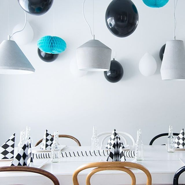 Series of concrete hanging lamps in a Scandinavian kitchen