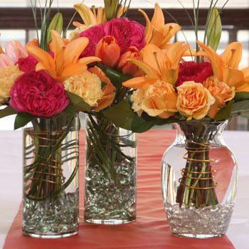 pretty. dollar tree - not the flowers but the way they are put in the vases - very pretty decoration