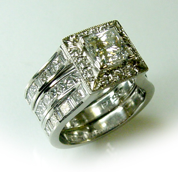 Chibnalls custom made ring re-model in Platinum using client's diamonds.