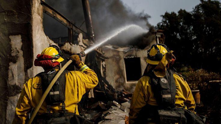 MONTECITO, CALIF. -- SUNDAY, DECEMBER 17, 2017: Humboldt County firefighters Bobby Gray, left, hoses