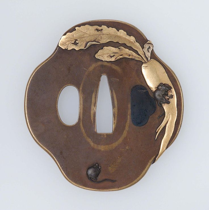 Tsuba with design of rats and daikon Japanese Edo period early to mid-19th century