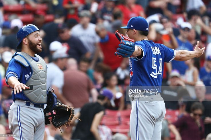 Roberto Osuna #54 of the Toronto Blue Jays and Russell Martin #55 celebrate after defeating the Boston Red Sox 8-6 at Fenway Park on July 20, 2017 in Boston, Massachusetts.