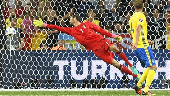 Goalkeeper Andreas Isaksson of Sweden fails to make a save during their UEFA EURO 2016 Group E match against Belgium