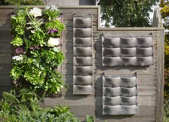 Plants on Walls – an easy vertical garden design  A friend send along a link to the Plants On Walls web site this morning and we just had to share. Check out these clever – and affordable – hanging vertical planters made with a wicking and felt-like material on a corrugated plastic backing.