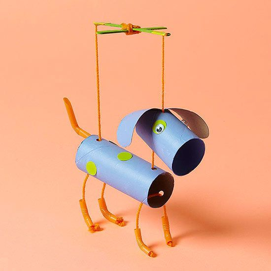 Transform cardboard tubes into a marionette; the ears are snipped from half a tube.  Instead of tubes, just construction paper.