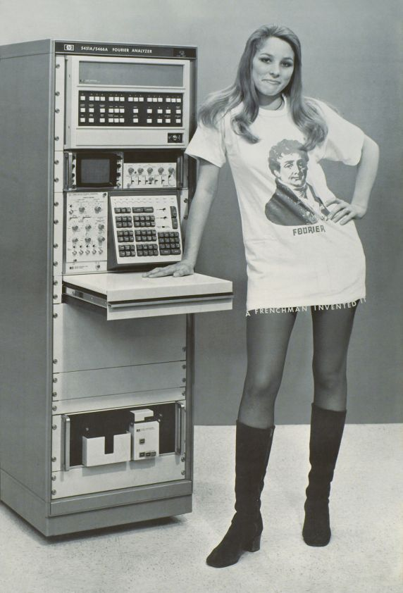 """Hewlett-Packard (HP) Fourier Analyzer 5451A, one of the first calculator - computer in the world. A funny photographic poster done by Berkeley University students in 1972. The text """"A Frenchman invented it"""" is written at the base of the miniskirt. It is a joke between the Mathematician Jean-Baptiste Joseph Fourier and the inventor of the miniskirt, both French!"""