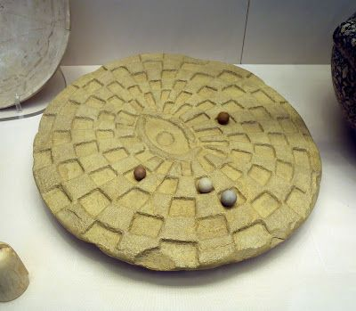 """Egyptian limestone game """"mehen"""" 2890 BC Mehen is a board game that was played in ancient Egypt. The game was named in reference to Mehen, a mythological snake-god. This is a Mehen gaming board (Naqada III or Early Dynastic, about 3000 BC); exact findspot is not known. It was used together with six lions (sometimes other animals) and six sets of balls/marbles."""