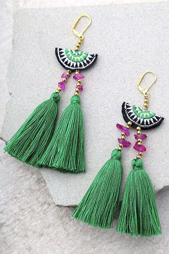 "Join the party in the Shashi Camilla Green Tassel Earrings! A green, black, and white embroidered bead with gold and purple beads tops trendy green tassels. Earrings measure 5"" long."