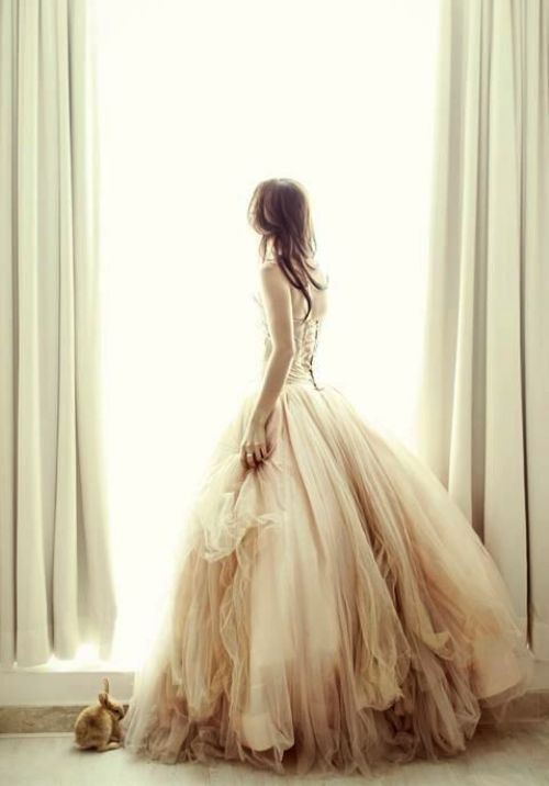 Multiple layers and blush champagne color make this memorable