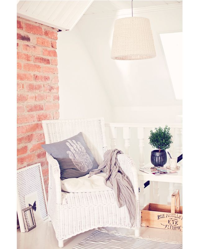 wicker chair and hanging light