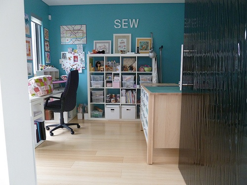 I definitely wouldn't mind having a large sewing room with lots of storage like this. I'm running out of room in mine.