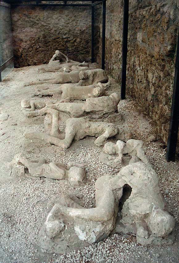 """""""Garden of the Fugitives"""". Plaster casts of victims still in situ; many casts are in the Archaeological Museum of Naples"""
