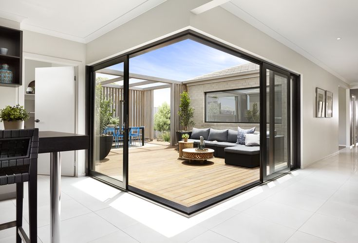 Striking corner sliding doors to an alfresco area. A&L corner door.