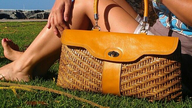 Handcrafted design rattan-leather bag: elegant and functional with a devider inside. Available in tangerine(pictured ), poppy red, black  and lime green.
