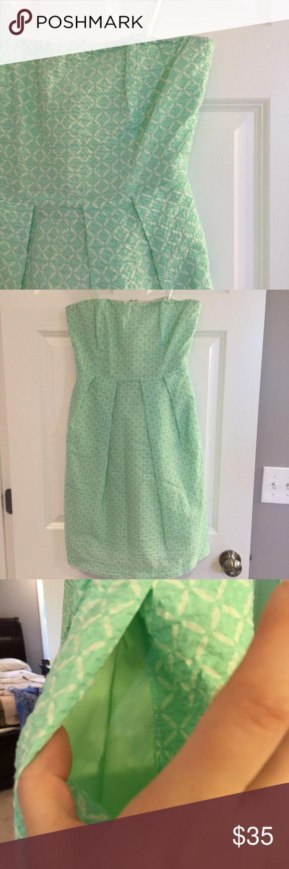 J. Crew Mint Green Strapless Summer Dress True to size. Waffle like fabric that is mint green with white diamonds. Has pockets and a bra elastic strap for suppose to hold it self up since it's strap less. Super cute and great for the coming up summer. J. Crew Dresses Strapless