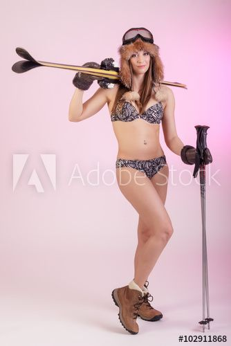 Nice pretty girl in lingerie with ski equipment