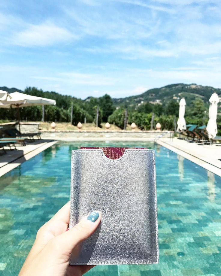 This passport sleeve in silver will protect your passport in style!