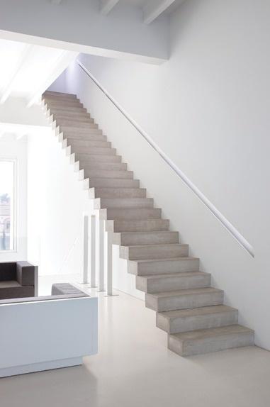 Concrete staircase in the house of José Gandía-Blasco, set in a renovated factory in Valencia.