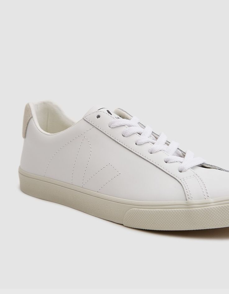 From Veja, a classic low top sneaker in Extra White. Flat woven laces. Padded collar. Subtle branding details. Tonal stitching. • Low-chrome leather upper • Recycled cotton and expensed rubber midsole • Wild rubber outsole • Made in Brazil • Women