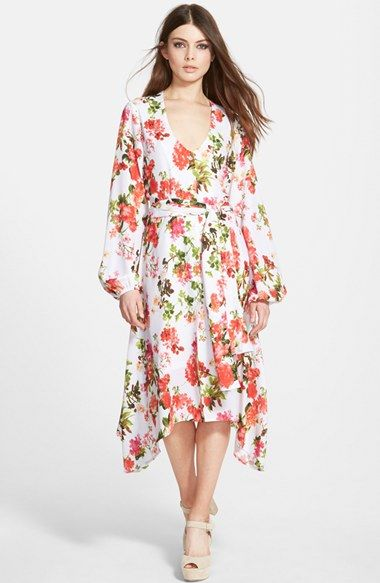 Free shipping and returns on Dirty Ballerina Handkerchief Hem Long Sleeve Dress at Nordstrom.com. Colorful blooms adorn a lovely V-neck dress styled for a refreshing look with a belted waistline, voluminous bishop sleeves and a fluttery handkerchief hem.