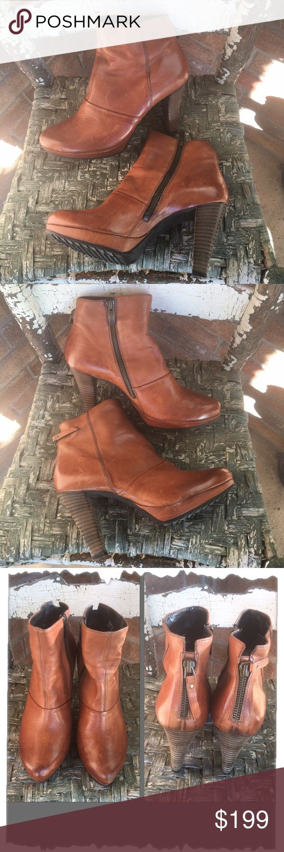 "Paul Green Munchen Tan Distressed Leather Boots Gorgeous Paul Green Munchen Tan Distressed Leather Boots. These are incredible and super comfy! Worn twice. Good condition! If you need more pictures or have questions please ask. Wood stacked heels are 4"" high with about a 1/2"" platform. Rubber soles for comfort and traction. Shaft is approx 6.5"" high. Inside functioning zipper. Backside decorative zipper. These are the perfect fall/winter boots. Wear them with jeans, skinniest, dress or…"