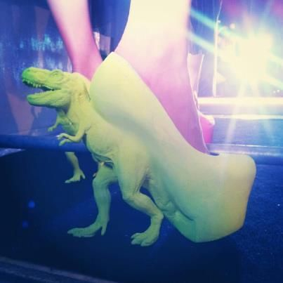 From blogger Pogona barbata on Tumblr: these are possibly the ugliest and coolest shoes i have ever seen.  would be so much better in a different shade of green (something less radioactive puke would be nice) and if the dinosaur was just the heel or something, looks a bit grotesque.