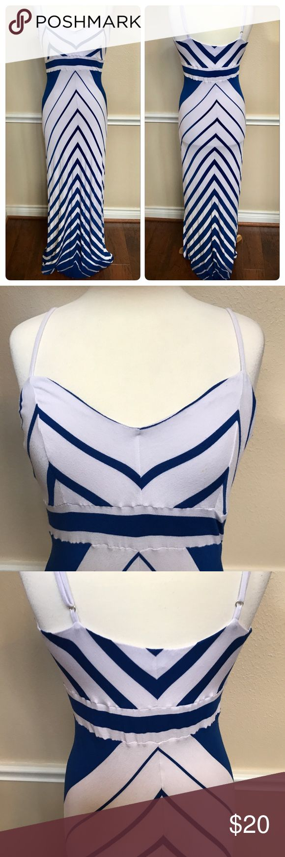 "BEBE Chevron Maxi dress Size L 🌸💕 BEBE Chevron Maxi dress Size L 🌸💕. Color is blue and white. Length is approx. 60"" long from where chest area begins to the bottom of dress. Shows some normal wear. Has some lint on the pit area and around the interior of chest area. See pictures. Also has a tiny stain in one side around chest area shown in pictures. It's a beautiful dress and still in good wearable condition. Remember to bundle and save 😊🎉 bebe Dresses Maxi"