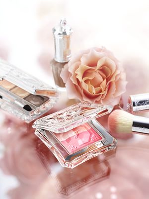 The makeup with clear case, fluffy brushes, flower, perfume are all so feminine.  I love the delicateness of it all.