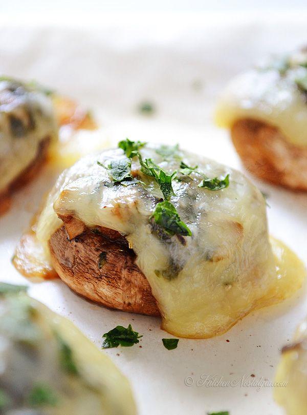 Baked Portobello Mushrooms - portobello mushrooms, olive oil (might reduce), garlic cloves, fresh parsley, fresh thyme, salt & pepper, cheese slices