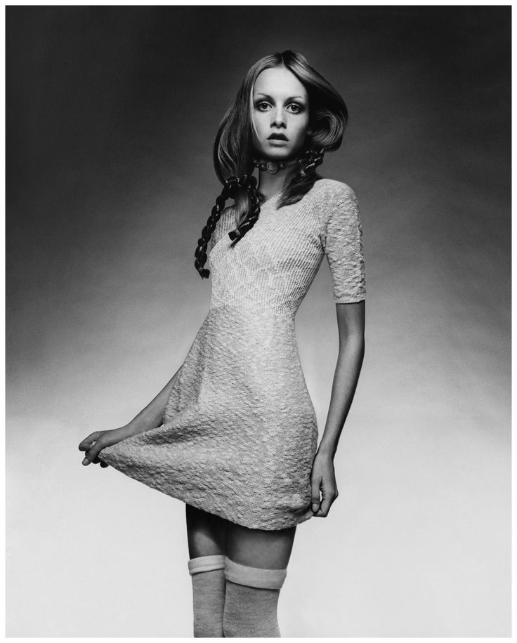 Twiggy wearing a knit baby-doll dress with ribbed bodice by Juliano Knits, with thigh- high socks, a choker by Mary Smith, and braids by Edith Imre. Photo Justin de Villeneuve, Vogue, April 15, 1970